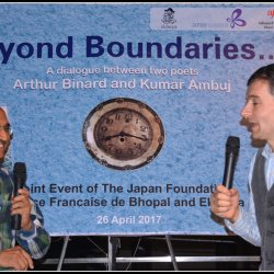 Poet Arthur Binard and poet Kumar Ambuj having a discussion during the event 'Beyond Boundaries…'